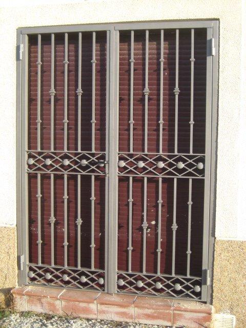 Rejas para ventanas y puertas Puertas corredizas hierro
